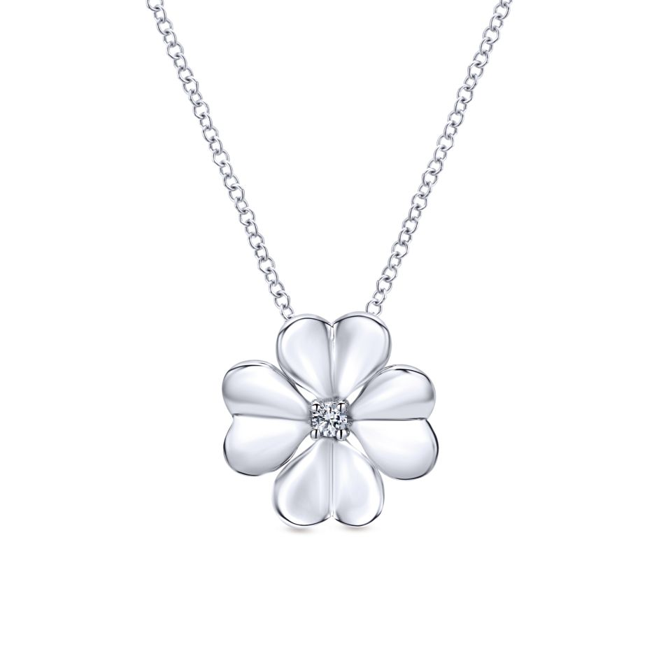 Stylized four leaf clover pendant, crafted from sterling silver with a white sapphire center